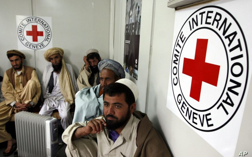 Afghans wait to talk with their relatives detained at U.S. military base in Bagram through a video conferencing system at the International Committee of the Red Cross (ICRC) office in Kabul, Afghanistan, Monday, April 14, 2008. The ICRC and the U.S. military set up the video conferencing system this year that allows the Bagram prisoners to speak with and see family members, the only outside contact the prisoners are allowed to have. (AP Photo/Musadeq Sadeq)